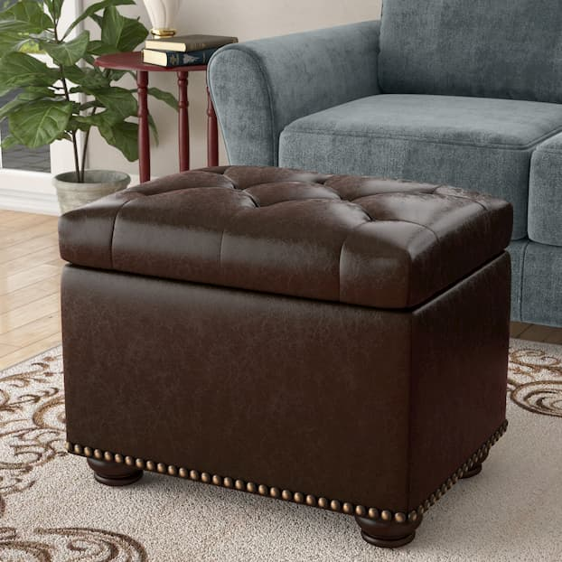 ottoman in front of the gray sofa