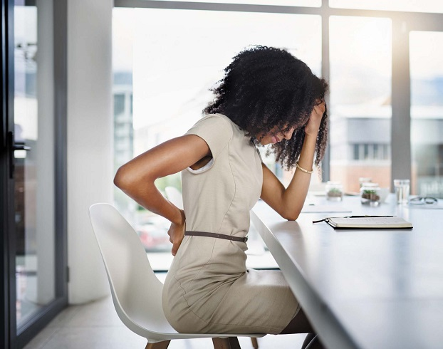 backpain caused by sitting in a chair