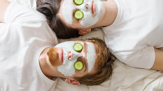 picture of a couple on bed having a night facial treatment