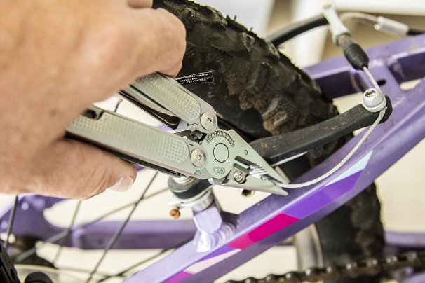 Working with multitool on a bike