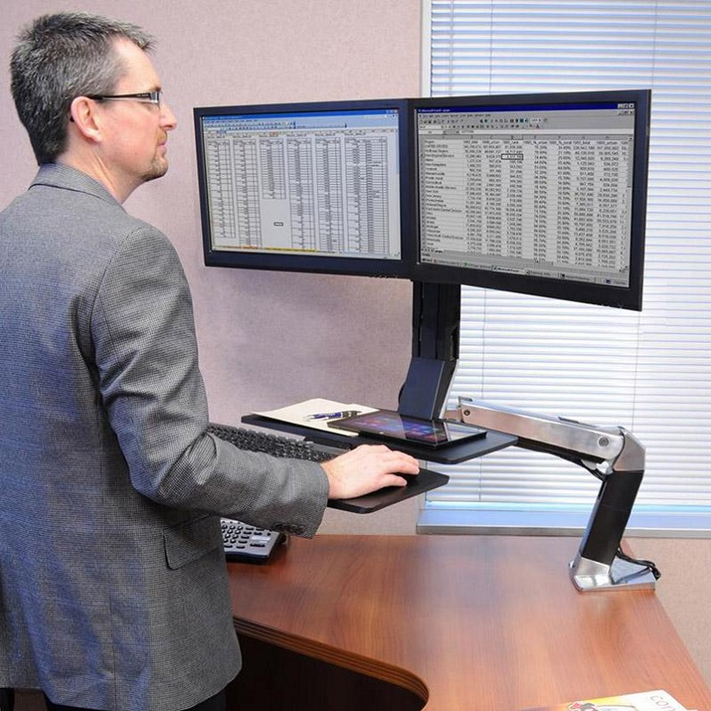 guy working on sit-stand workstations