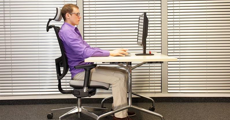 a guy sitting on ergonomics chair