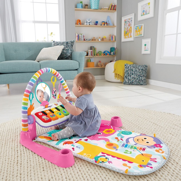 picture of a baby on the floor on a play gym mat in the living room